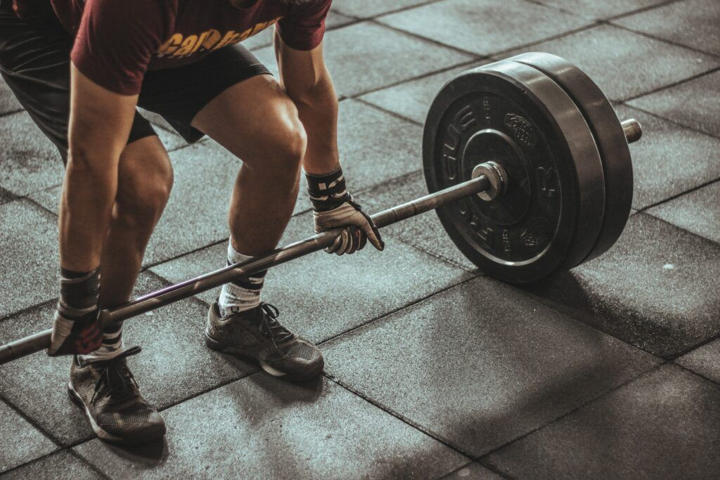 Heavy Barbell Weightlifting in the Gym