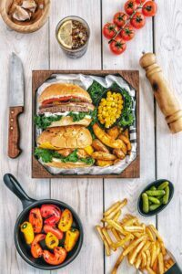 Burger with fries and tomatoes
