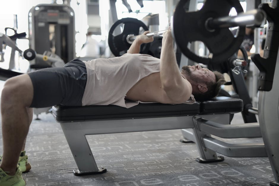 A person doing Barbell Bench Press for Chest