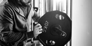 Weight Training In the Gym with a Barbell