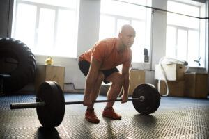 Man Performing the Conventional Barbell Deadlift